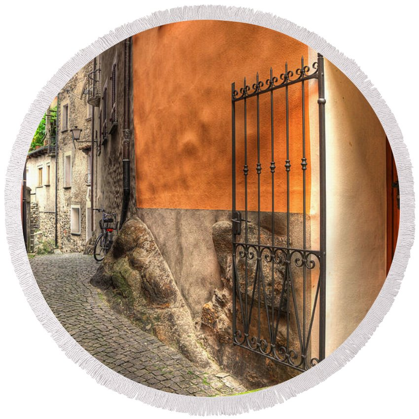 Alley Round Beach Towel featuring the photograph Old Colorful Rustic Alley by Mats Silvan