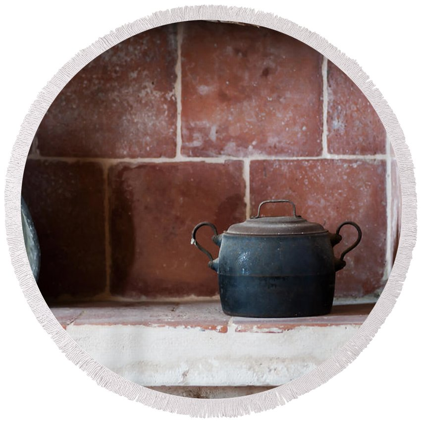 Scene Round Beach Towel featuring the photograph old kitchen - A part of a traditional kitchen with a vintage metal pot by Pedro Cardona Llambias