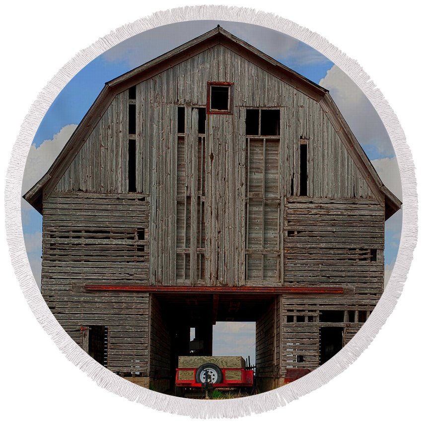 Abandoned Round Beach Towel featuring the photograph Old Wagon Older Barn Panoramic Stitch by Alan Look