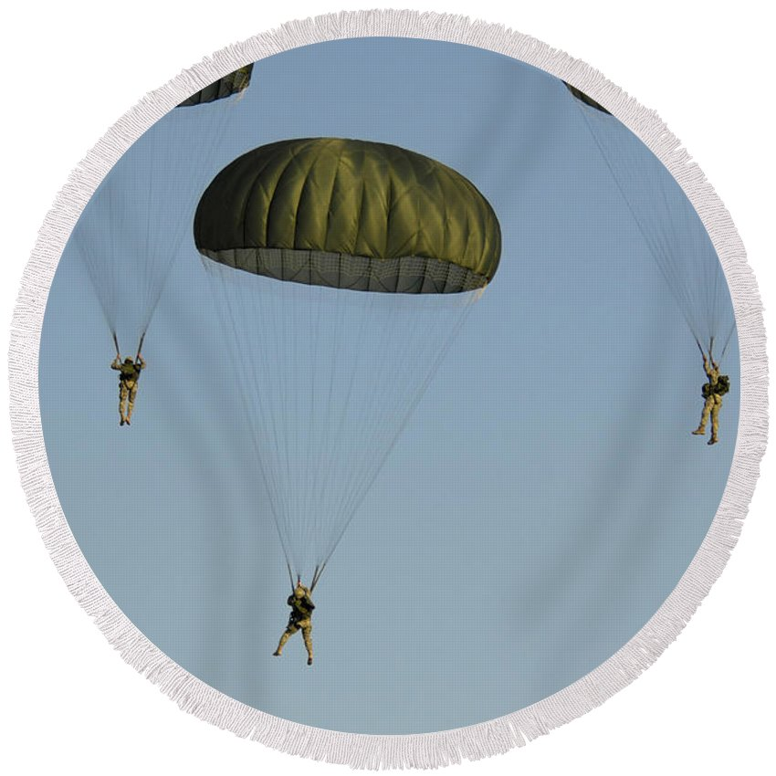 82nd Airborne Division Round Beach Towel featuring the photograph Paratroopers Descend Through The Sky by Stocktrek Images