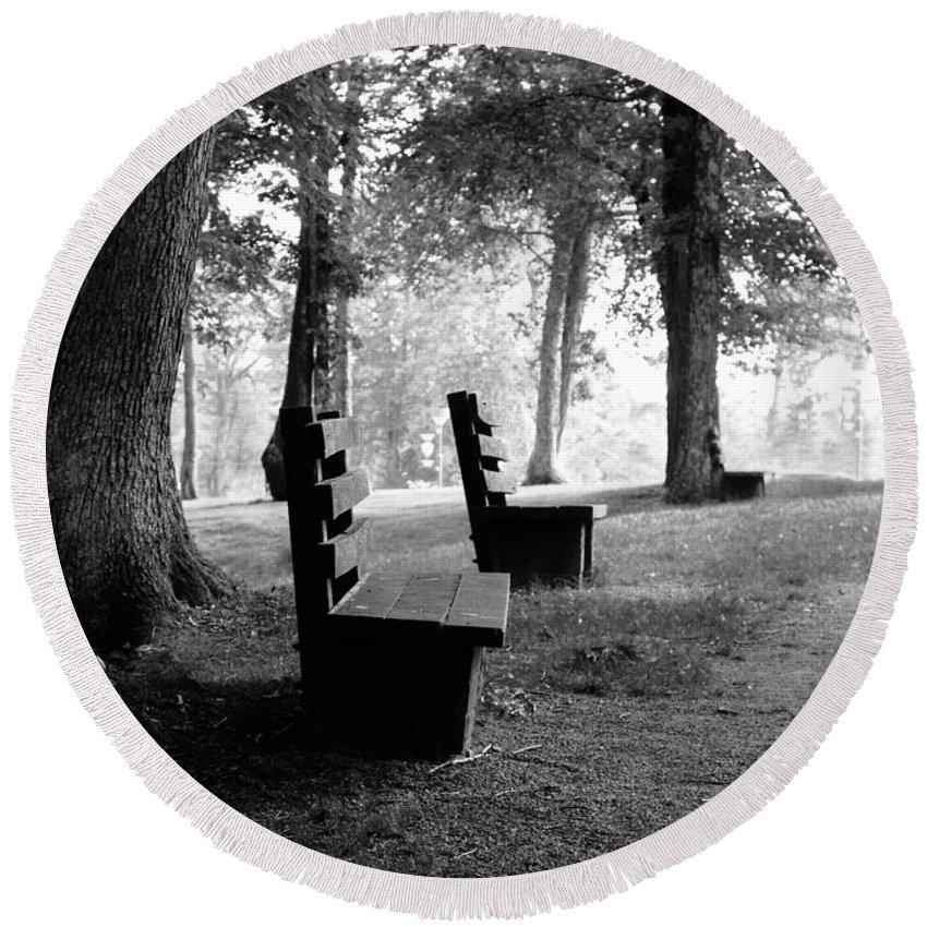 Black And White Round Beach Towel featuring the photograph Park Bench In Black And White by Lj Lambert