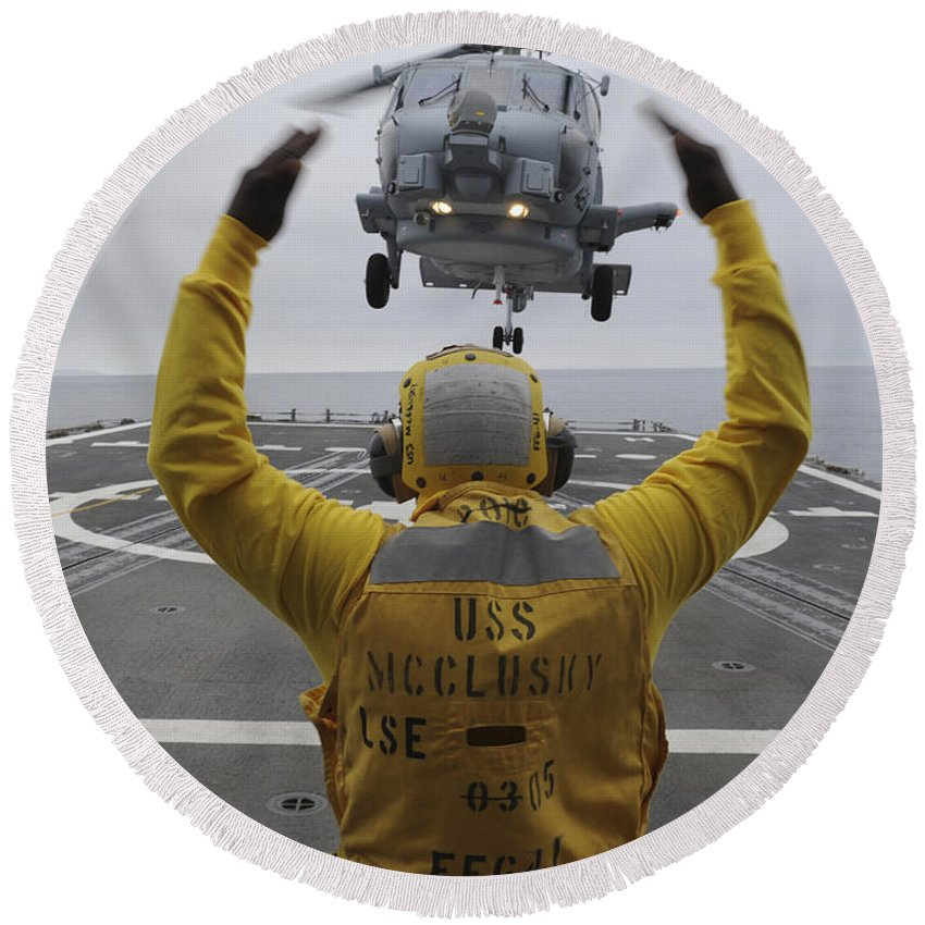 Guided Missile Frigate Round Beach Towel featuring the photograph Petty Officer Guides An Sh-60r Sea Hawk by Stocktrek Images
