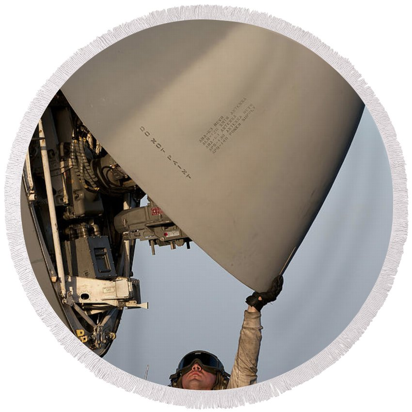 Inspecting Round Beach Towel featuring the photograph Petty Officer Inspects The Radar Of An by Stocktrek Images