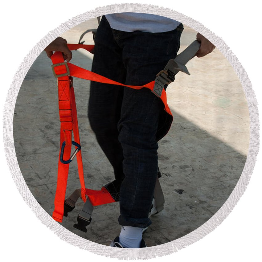 Orange Round Beach Towel featuring the photograph Preparing To Fit The Harness by Ashish Agarwal