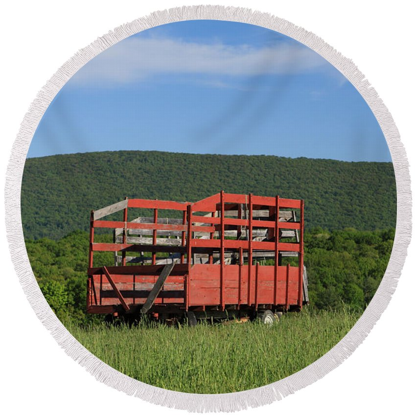 Agriculture Round Beach Towel featuring the photograph Red Hay Wagon In Green Mountain Field by John Stephens