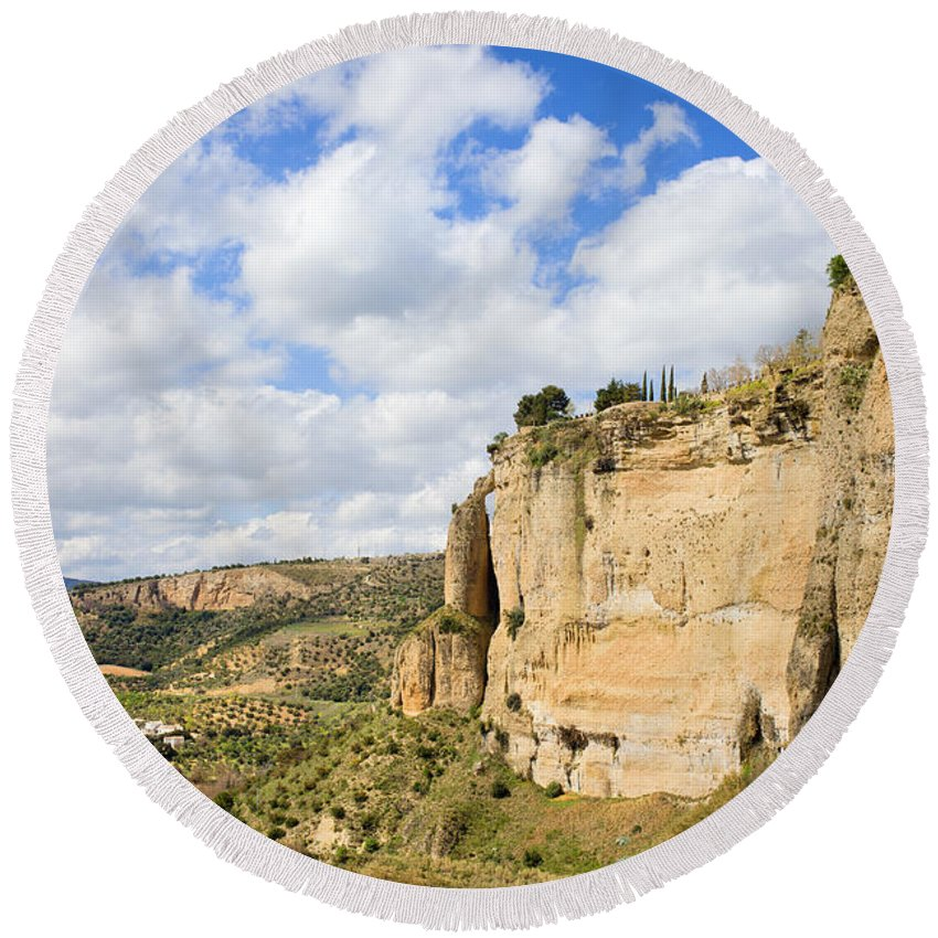 Andalucia Round Beach Towel featuring the photograph Ronda Cliffs In Andalusia by Artur Bogacki