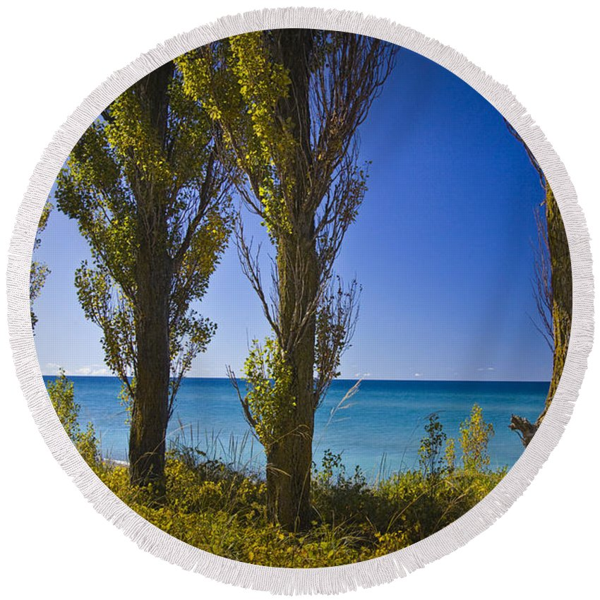 Art Round Beach Towel featuring the photograph Row Of Cypress Trees At Point Betsie In Michigan No.0924 by Randall Nyhof