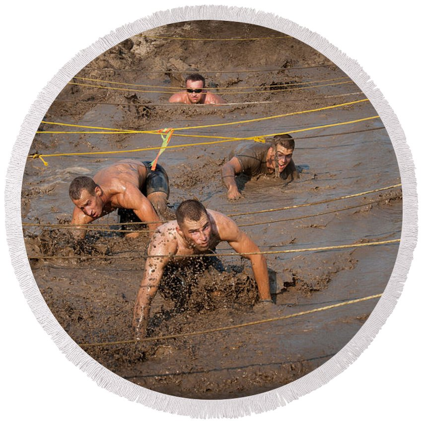 Recreation Round Beach Towel featuring the photograph Runners Navigate An Obstacle Course by Stocktrek Images