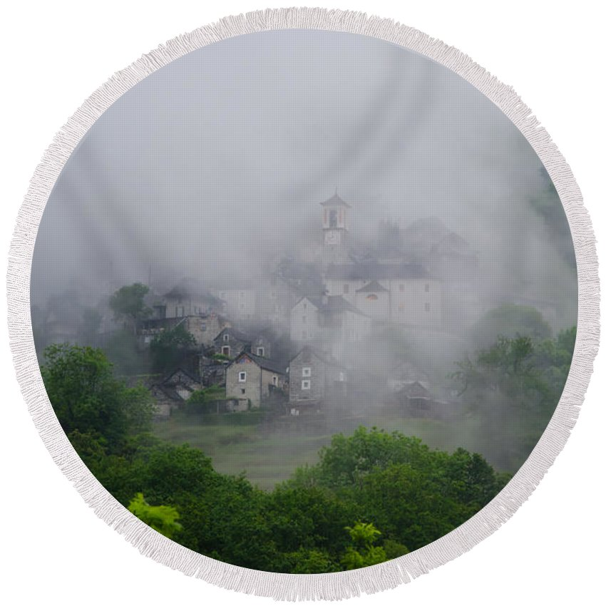 Village Round Beach Towel featuring the photograph Rustic Village In The Fog by Mats Silvan
