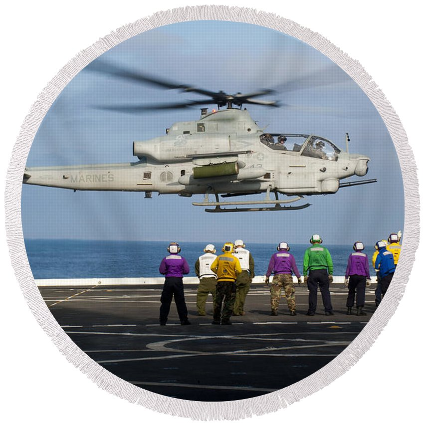 Uss New Orleans Round Beach Towel featuring the photograph Sailors And Marines Watch An Ah-1z by Stocktrek Images