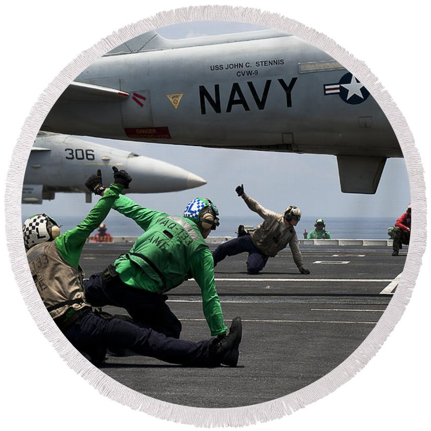 Uss John C Stennis Round Beach Towel featuring the photograph Sailors Give Launch Approval For An by Stocktrek Images