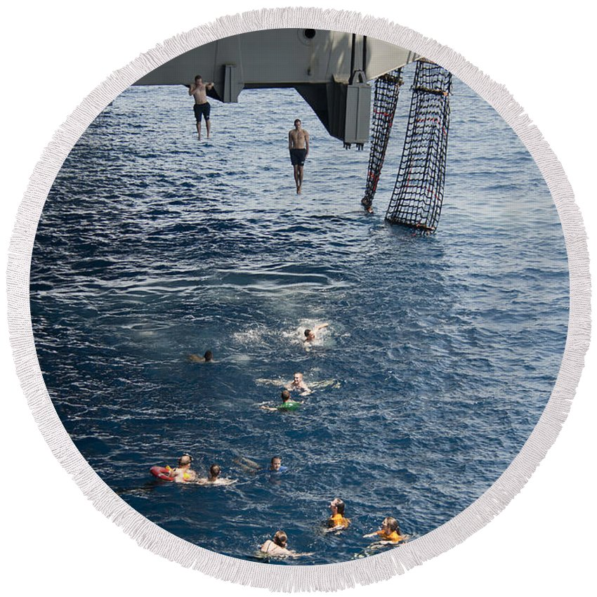 Uss Carl Vinson Round Beach Towel featuring the photograph Sailors Jump To The Sea During A Swim by Stocktrek Images