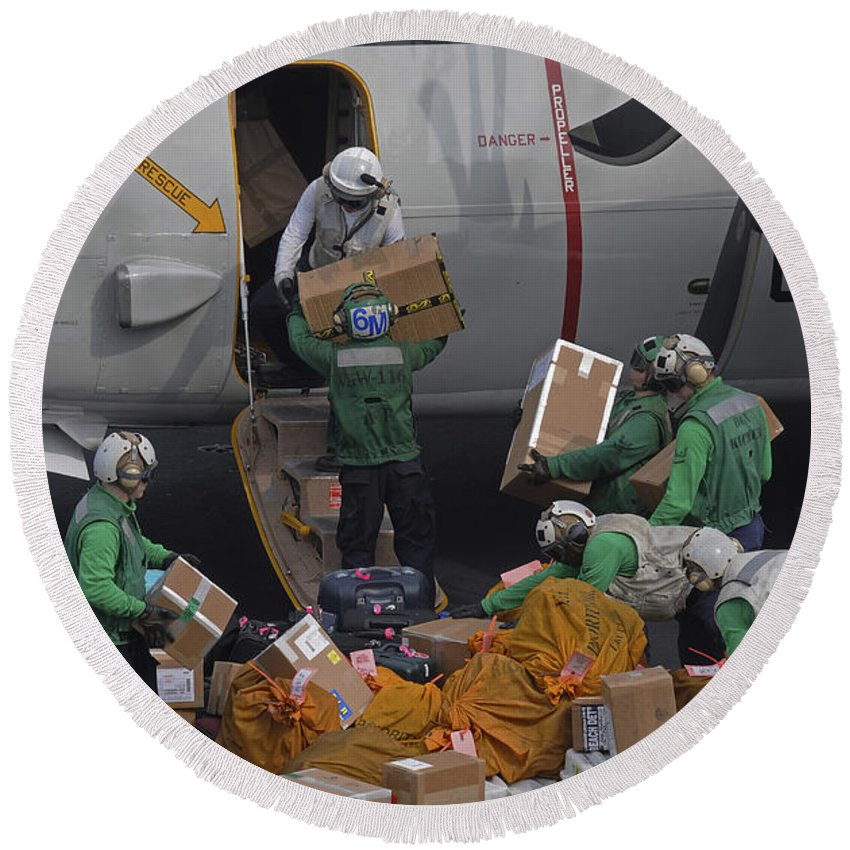 Military Round Beach Towel featuring the photograph Sailors Load Mail On To A C-2a by Stocktrek Images