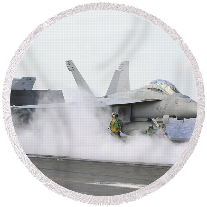 Uss George Washington Round Beach Towel featuring the photograph Sailors Prepare An Fa-18f Super Hornet by Stocktrek Images