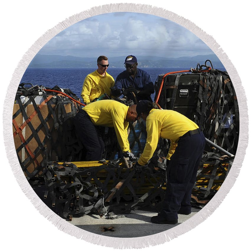 Connection Round Beach Towel featuring the photograph Sailors Prepare Pallets Of Cargo Aboard by Stocktrek Images