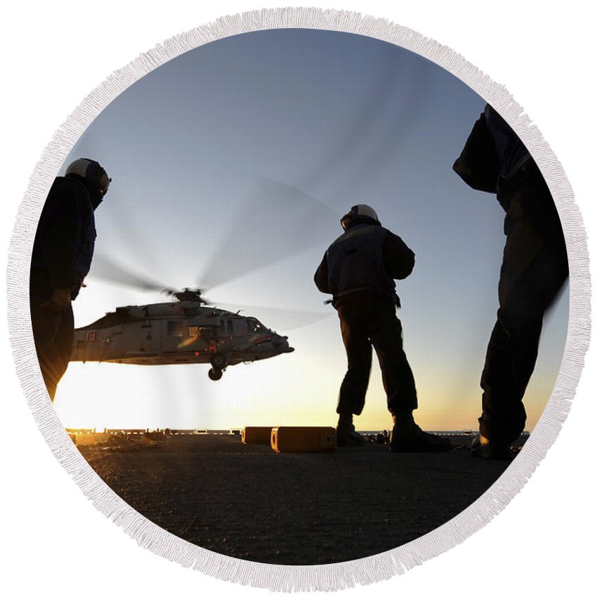 Military Round Beach Towel featuring the photograph Sailors Watch A Helicopter Lift by Stocktrek Images