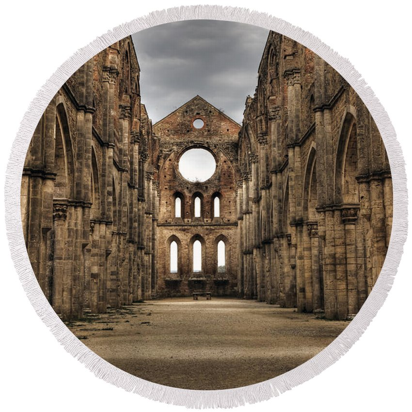 Ruins Round Beach Towel featuring the photograph San Galgano - A Ruin Of An Old Monastery With No Roof by Joana Kruse