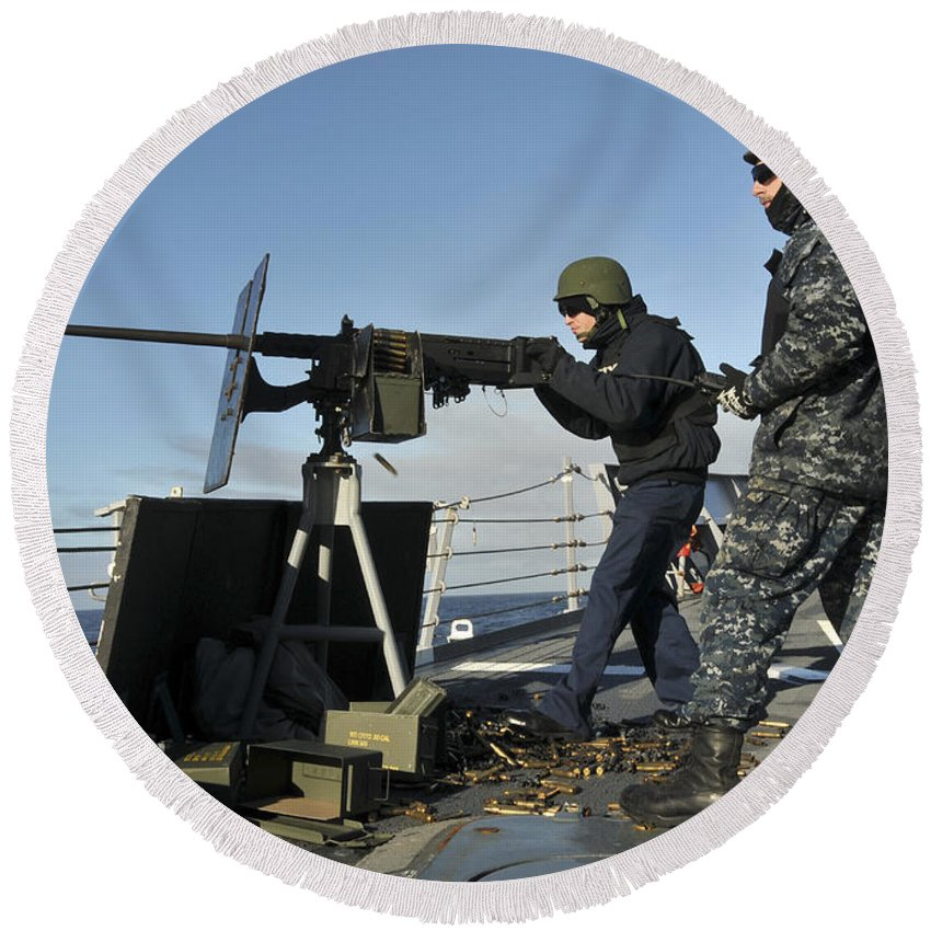 Gunner Round Beach Towel featuring the photograph Seaman Fires A .50 Caliber Machine Gun by Stocktrek Images