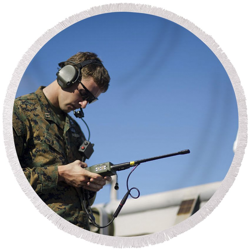 Receiver Round Beach Towel featuring the photograph Soldier Conducts A Communications Check by Stocktrek Images