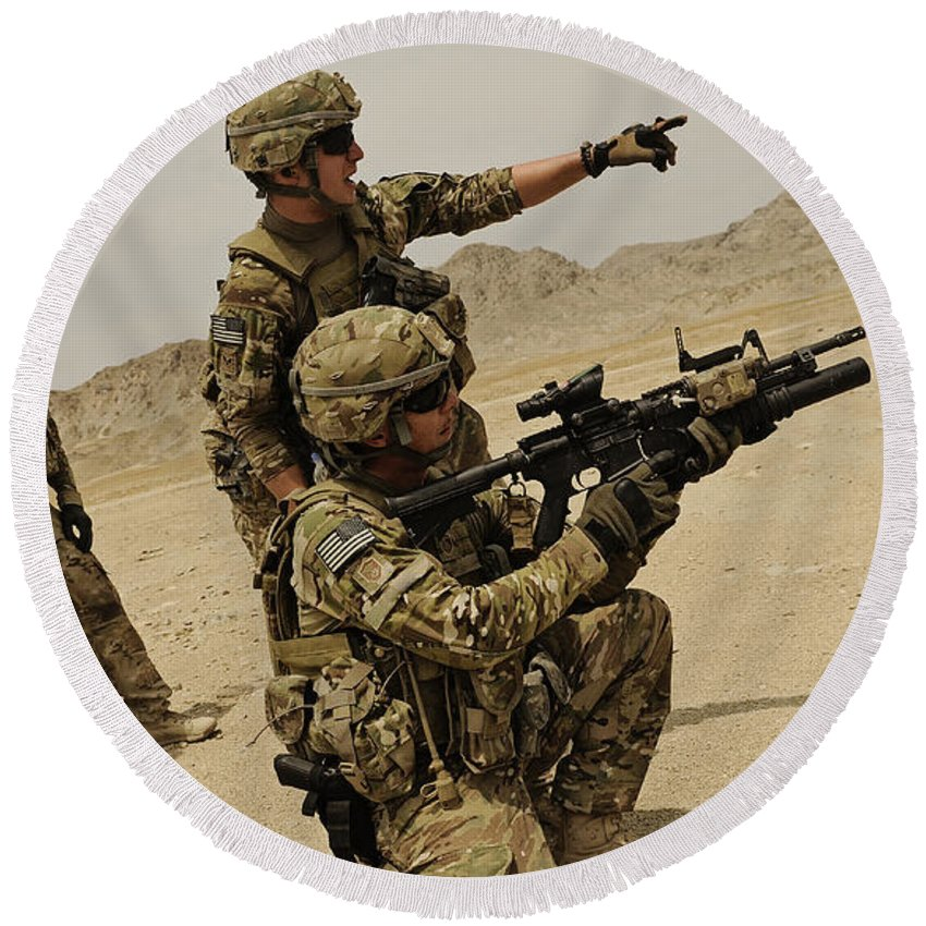 Army Round Beach Towel featuring the photograph Soldier Directing A Fellow Soldier by Stocktrek Images