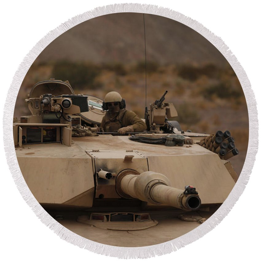 Military Round Beach Towel featuring the photograph Soldier Looks Out The Main Hatch by Stocktrek Images