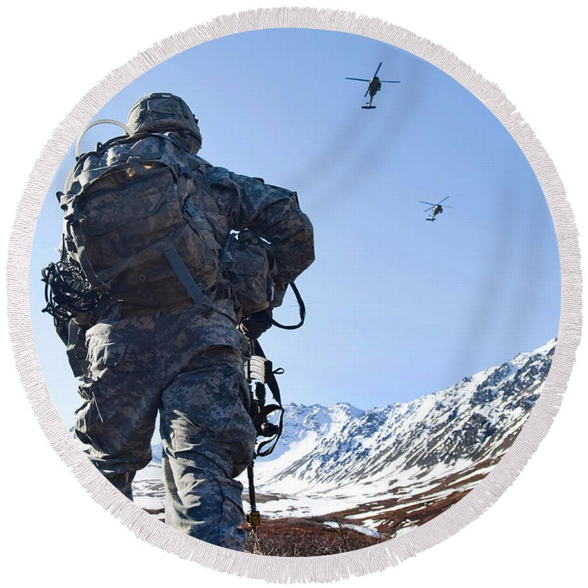 Army Round Beach Towel featuring the photograph Soldier Patrols Through Alaska's by Stocktrek Images