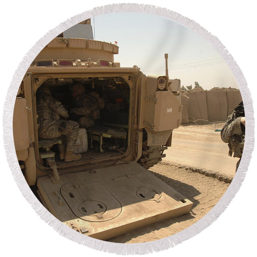 Army Round Beach Towel featuring the photograph Soldiers Climb Into The Back Of A M2 by Stocktrek Images