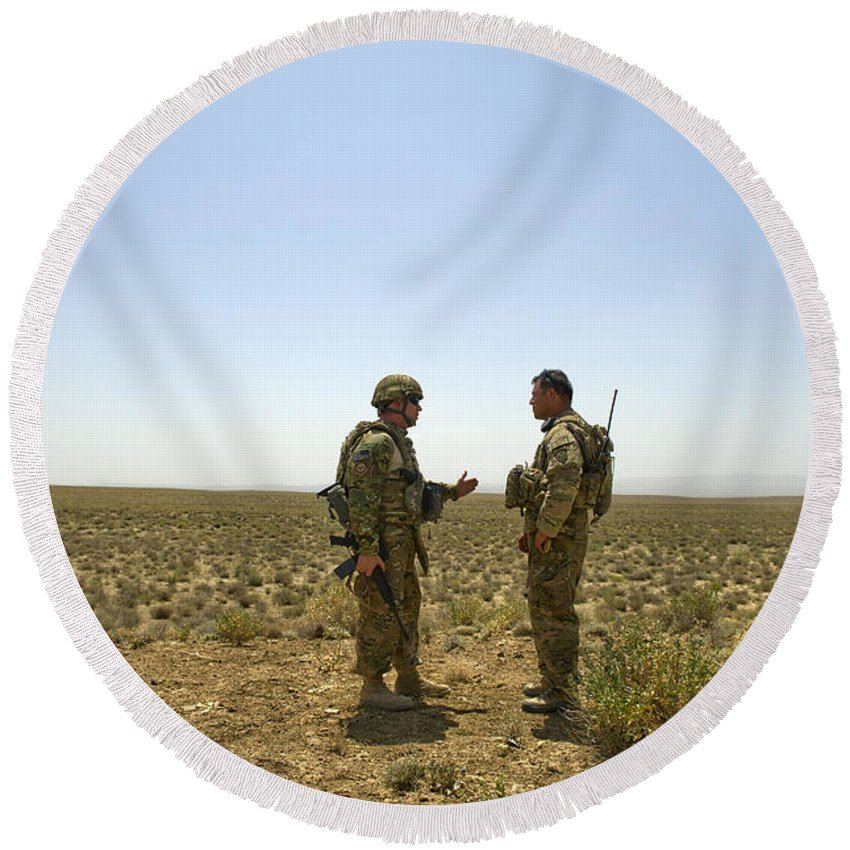 Afghanistan Round Beach Towel featuring the photograph Soldiers Discuss, Drop Zone by Stocktrek Images