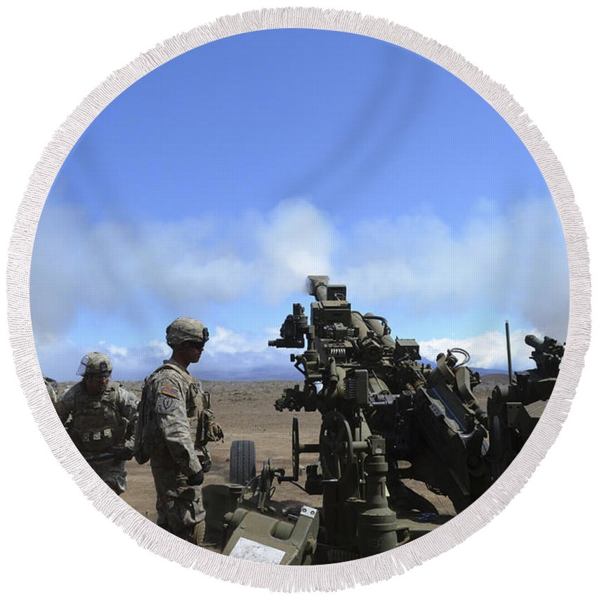 Military Round Beach Towel featuring the photograph Soldiers Firing The M777 Howitzer by Stocktrek Images