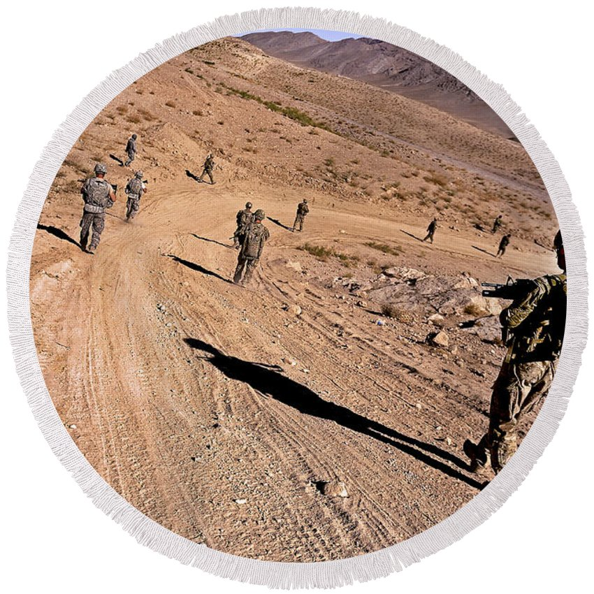 Provincial Reconstruction Team Round Beach Towel featuring the photograph Soldiers Patrol To A Village by Stocktrek Images