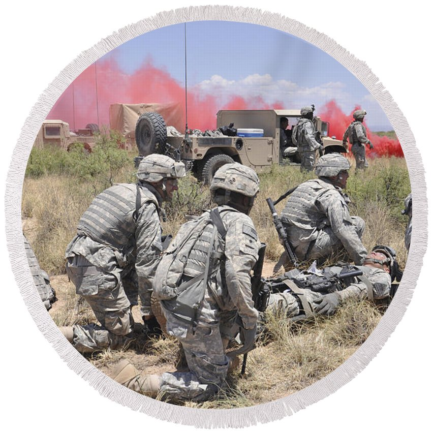 White Sands Missile Range Round Beach Towel featuring the photograph Soldiers Prepare To Transport A Wounded by Stocktrek Images