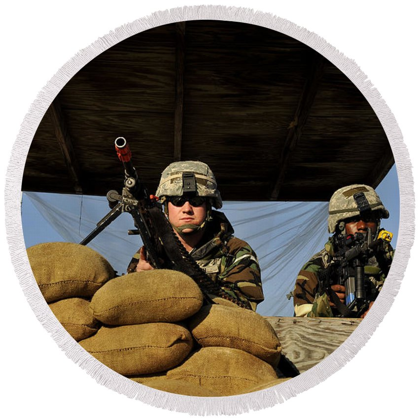 Assault Weapons Round Beach Towel featuring the photograph Soldiers Provide Security by Stocktrek Images