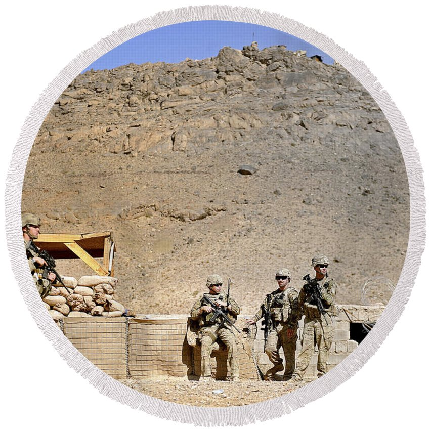 Provincial Reconstruction Team Round Beach Towel featuring the photograph Soldiers Wait For Afghan National by Stocktrek Images