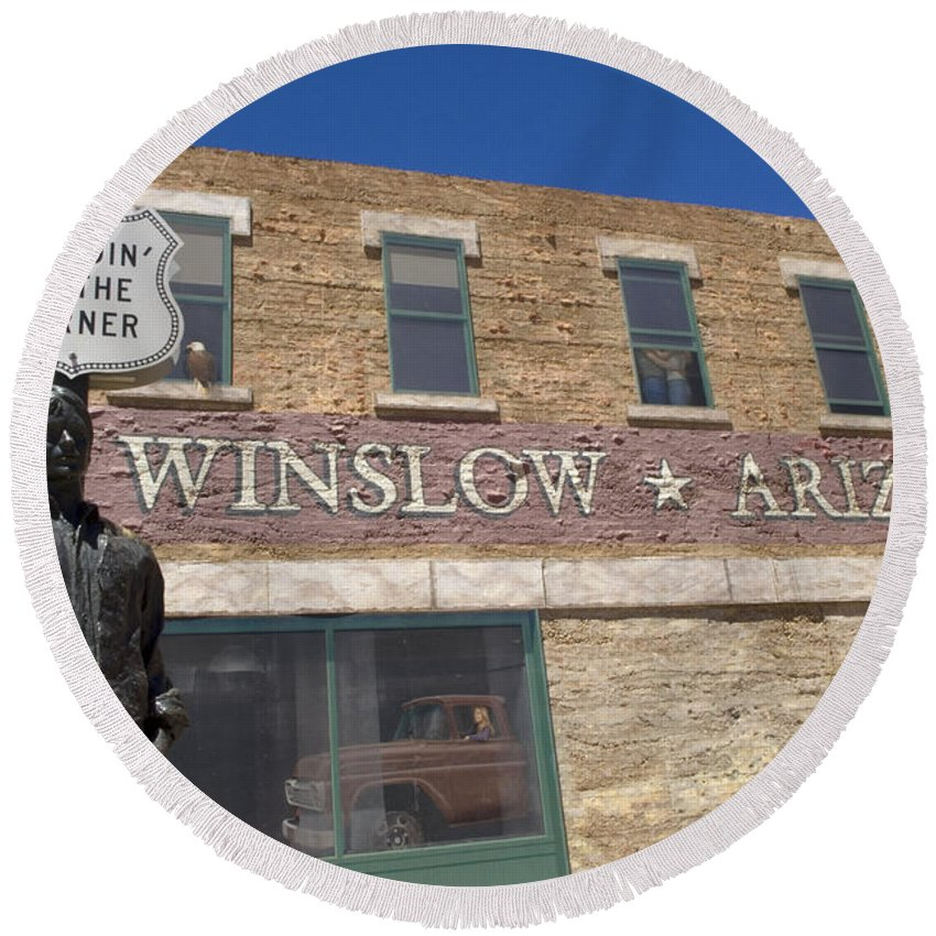 Winslow Arizona Round Beach Towel featuring the photograph Standin On The Corner In Winslow Arizona by Bob Christopher