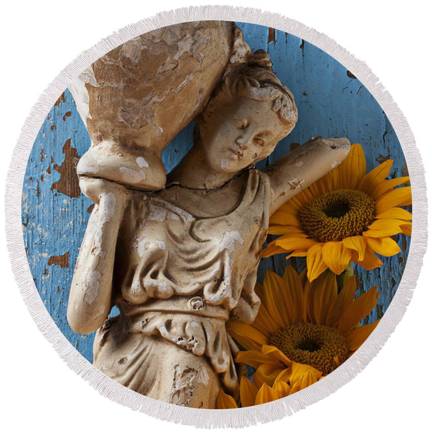 Statue Round Beach Towel featuring the photograph Statue Of Woman With Sunflowers by Garry Gay