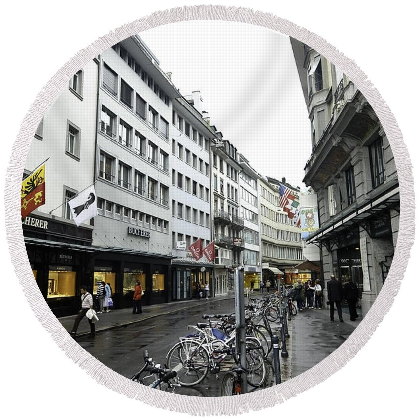 Action Round Beach Towel featuring the photograph Street In Lucerne With Cycles And Rain by Ashish Agarwal