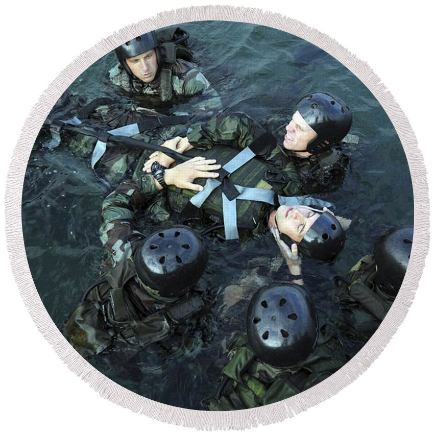 Navy Seals Round Beach Towel featuring the photograph Students Secure A Simulated Casualty by Stocktrek Images