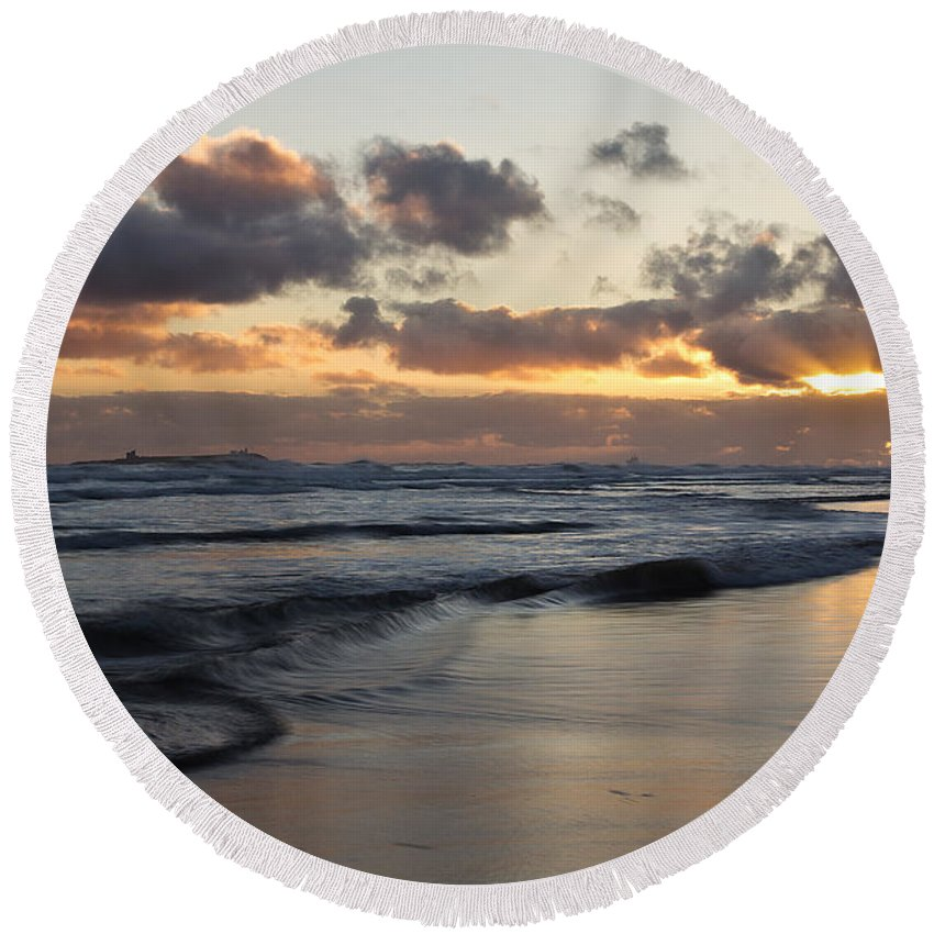 Seascape Round Beach Towel featuring the photograph Sunrise At Bamburgh Beach by David Pringle