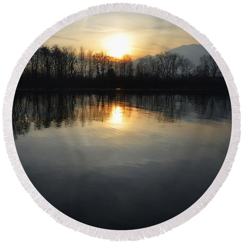 Sun Round Beach Towel featuring the photograph Sunset Over A Lake by Mats Silvan
