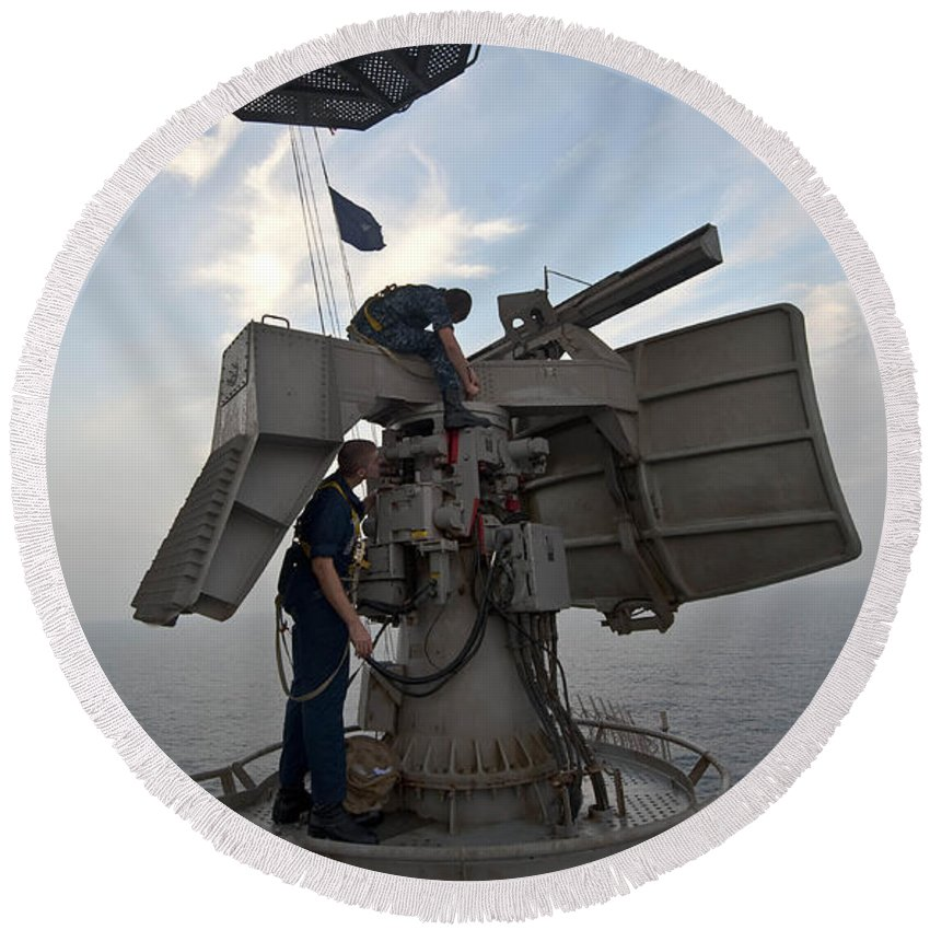 Operation New Dawn Round Beach Towel featuring the photograph Technicians Performs Maintenance by Stocktrek Images