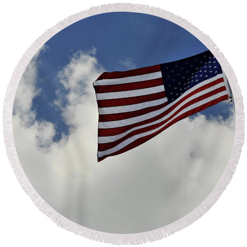 United We Stand Round Beach Towel featuring the photograph The American Flag Blowing In The Breeze by Stocktrek Images