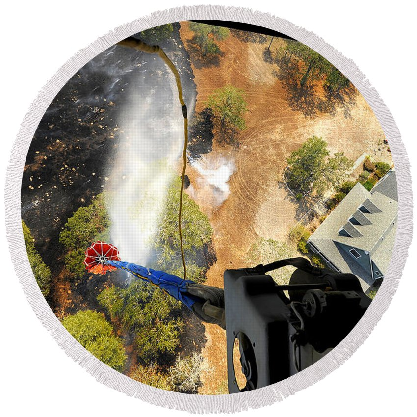 Hanging Round Beach Towel featuring the photograph The Bambi Bucket Attached To A Ch-47 by Stocktrek Images
