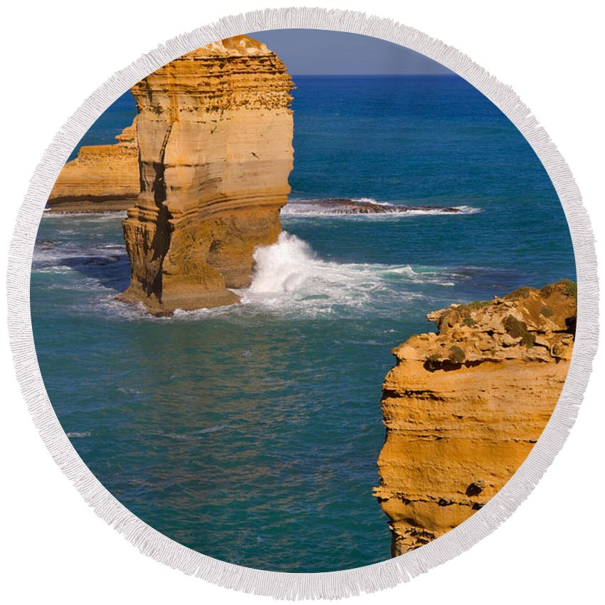 Twelve Apostles Round Beach Towel featuring the photograph The Twelve Apostles In Port Campbell National Park Australia by Louise Heusinkveld