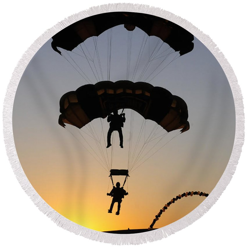 U.s. Army Golden Knights Round Beach Towel featuring the photograph The U.s. Army Golden Knights Perform An by Stocktrek Images