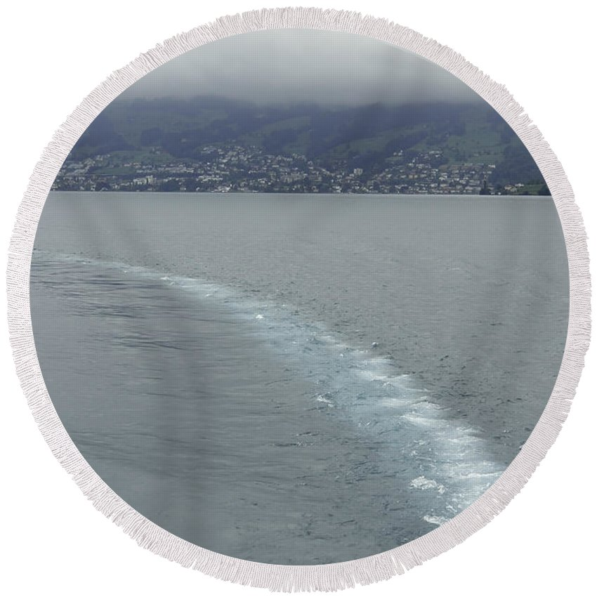 Action Round Beach Towel featuring the photograph The Wake Of A Cruise Ship In Lake Lucerne by Ashish Agarwal