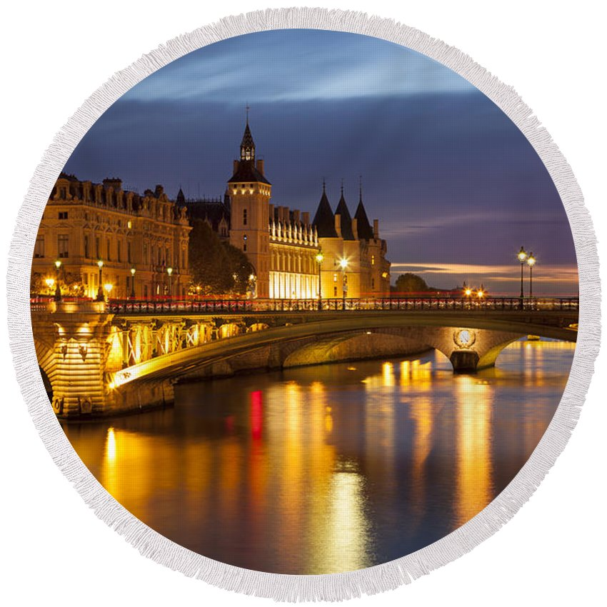 Architectural Round Beach Towel featuring the photograph Twilight Over River Seine And Conciergerie by Brian Jannsen