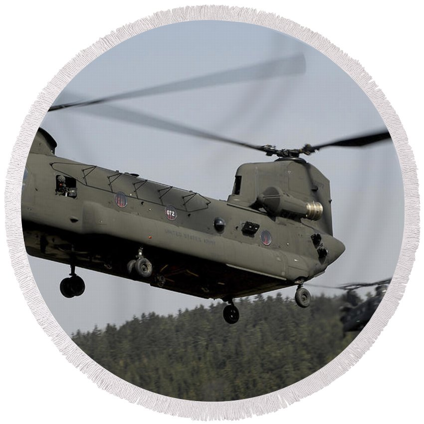 Army Round Beach Towel featuring the photograph Two Ch-47 Chinook Helicopters In Flight by Stocktrek Images
