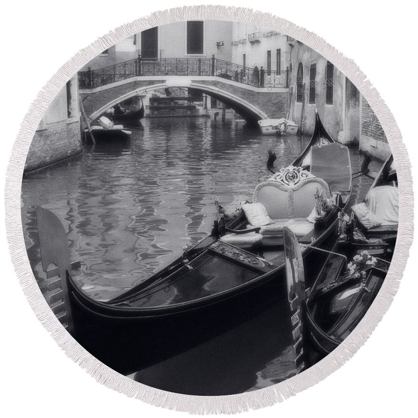 Gondolas Round Beach Towel featuring the photograph Two Docked Gondolas On A Venice Canal by Greg Matchick