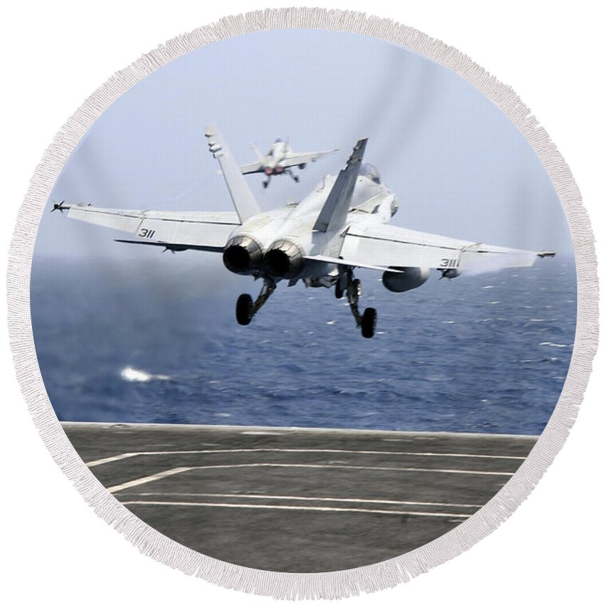 Aircraft Carrier Round Beach Towel featuring the photograph Two Fa-18c Hornet Strike Fighters by Stocktrek Images