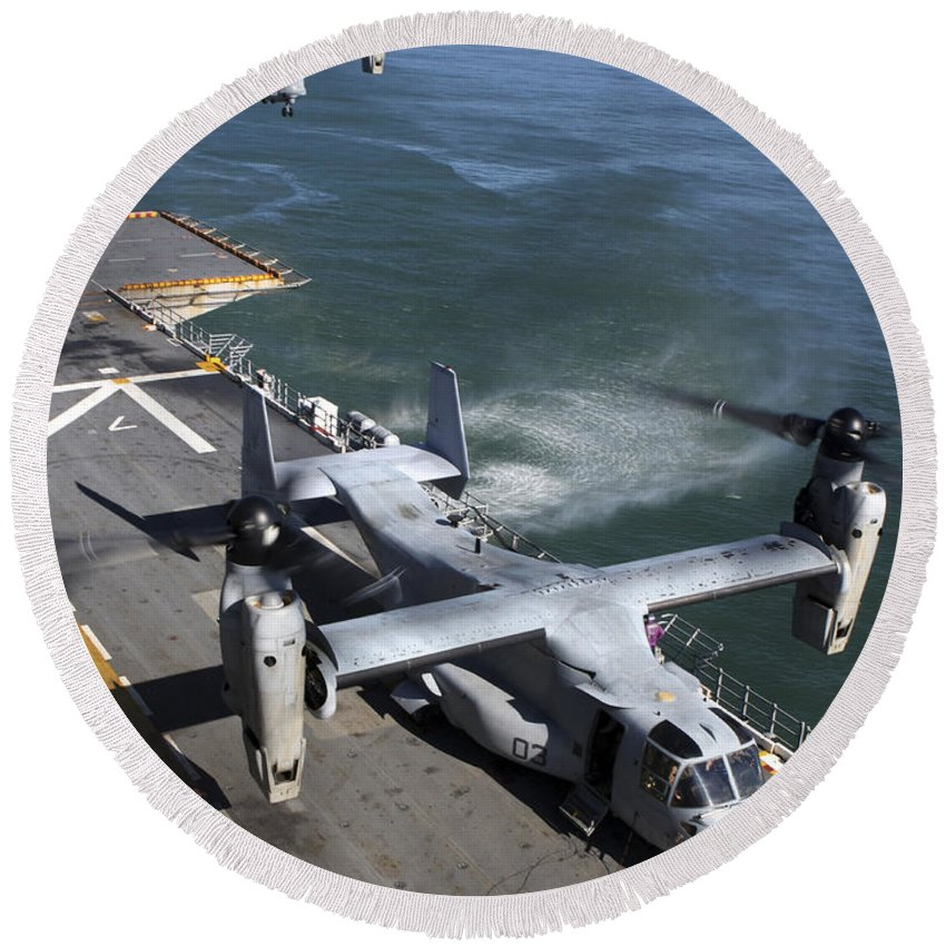 Uss Nassau Round Beach Towel featuring the photograph Two Mv-22 Ospreys Land On The Flight by Stocktrek Images